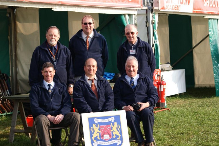 Clay pigeon shooting instructors on show stand