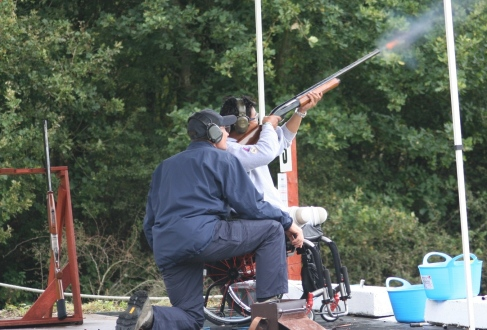 Wheel Chair Clay Pigeon shooter under instruction